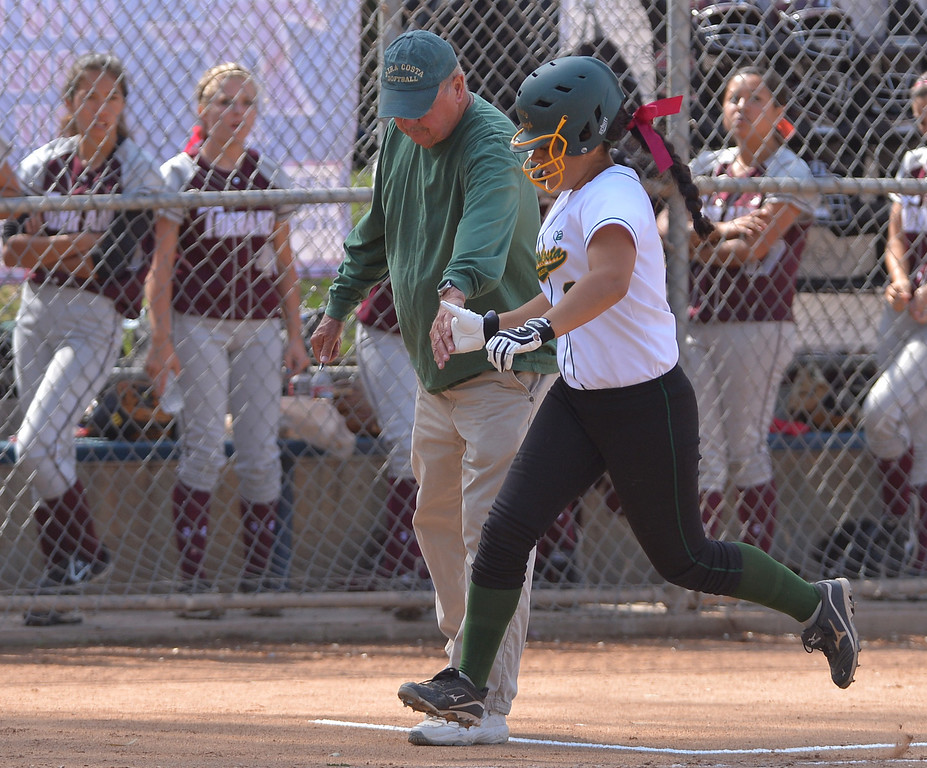 . 0517_SPT_TDB-L-MC-TORRANCE--- Torrance, CA--5/16/13--- Staff Photo: Robert Casillas  - Daily Breeze / LANG--- Mira Costa defeated Torrance High 7-1 in CIF DIV III softball playoff game at Wilson Park in Torrance. Brittany Werre meets coach Richard Amberik at third base after her homerun.
