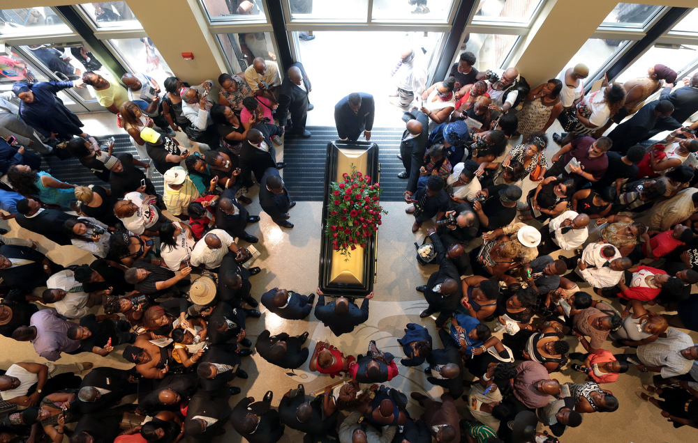 Description of . A casket containing the body of Michael Brown is wheeled out Monday, Aug. 25, 2014, at Friendly Temple Missionary Baptist Church in St. Louis. Hundreds of people gathered to say goodbye to Brown, who was shot and killed by a Ferguson, Mo., police officer on Aug. 9. (AP Photo/St. Louis Post Dispatch, Robert Cohen, Pool)