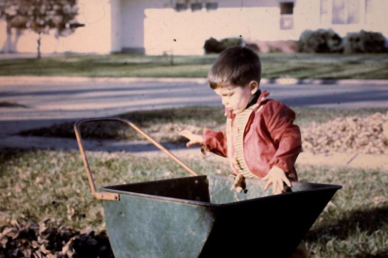 Randy 16 mos helping Grandpa John rake Brookings.jpg