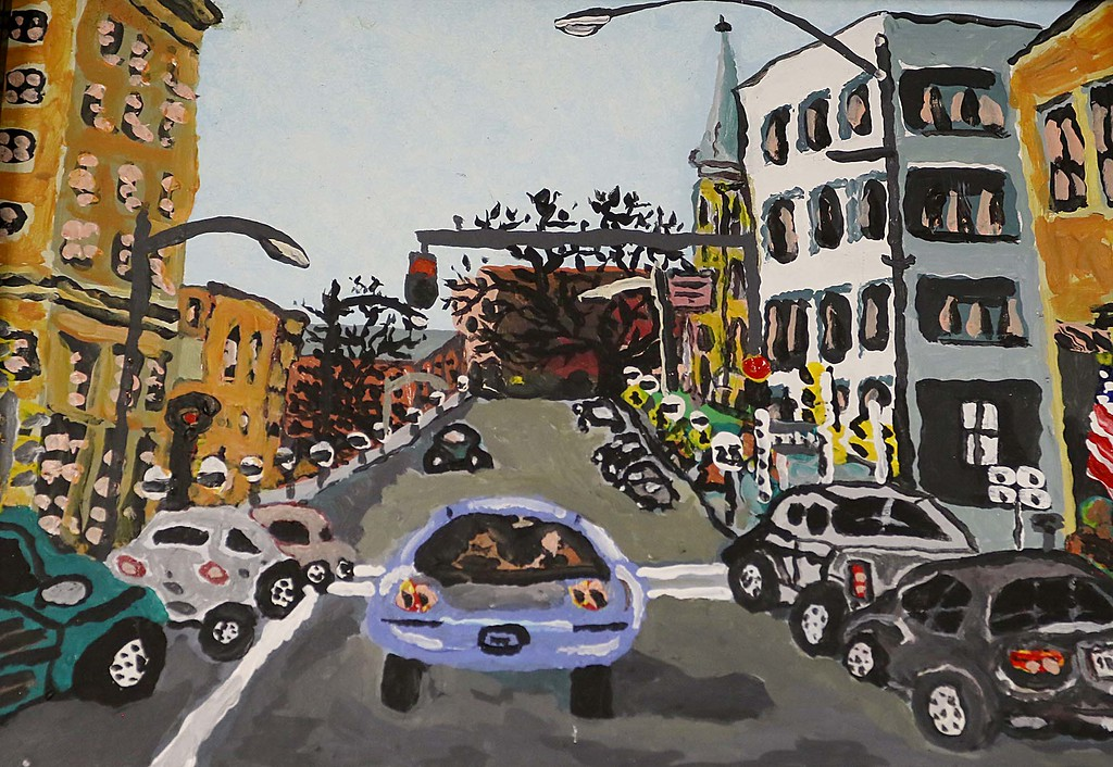 . Artist Kevin McCarthy, 62, of Fitchburg had an art show of some of his work this week at the Fitchburg Senior Center. this piece in the show was a painting of Fitchburg Main Street. SENTINEL & ENTERPRISE/JOHN LOVE