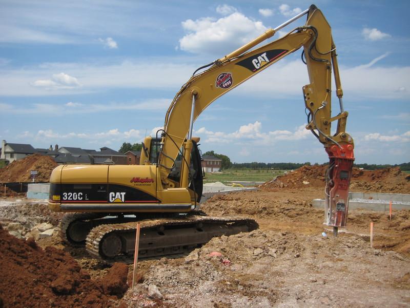 NPK GH9 hydraulic hammer (sn 91377) on Cat excavator (10).jpg