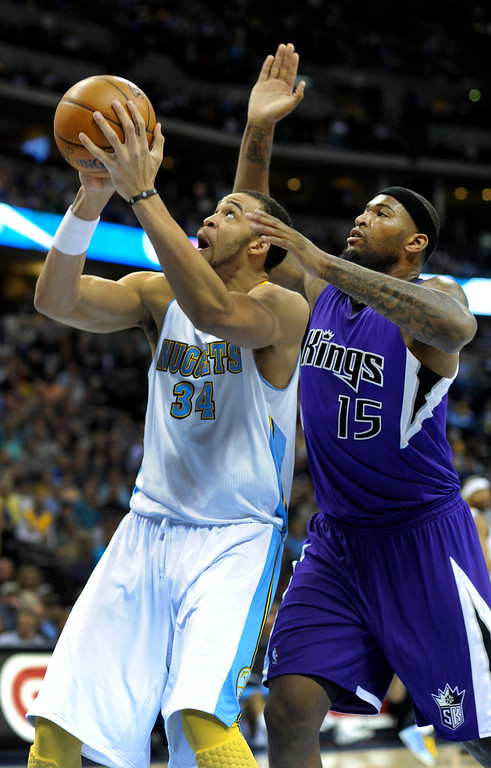 . DENVER, CO. - MARCH 22: JaVale McGee (34) of the Denver Nuggets worked underneath DeMarcus Cousins (15) of the Sacramento Kings in the first half. The Denver Nuggets hosted the Sacramento Kings Saturday night, March 23, 2013 at the Pepsi Center. (Photo By Karl Gehring/The Denver Post)