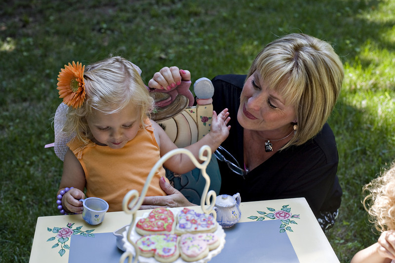 Sweetness....you are a beautiful Grandma! and i love that it is a childhood vintage table.