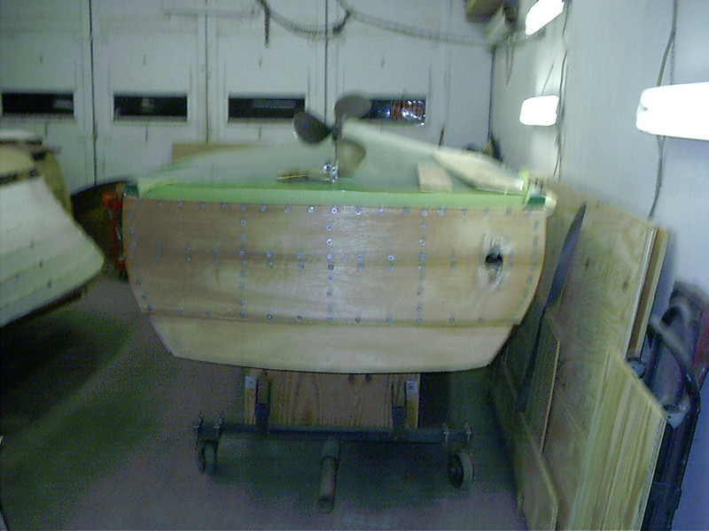 Bottom two transom planks glued in place.