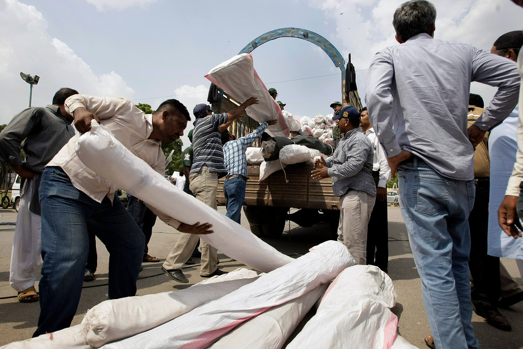 . Pakistan volunteers load relief supplies for earthquake-affected people of the Baluchistan province, in Karachi, Pakistan, Wednesday, Sept. 25, 2013. (AP Photo/Fareed Khan)
