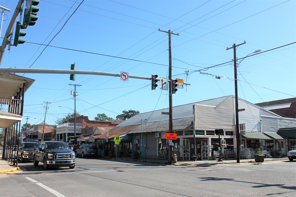 A short row of buildings come together at an intersection in the Cajun town of Breaux Bridge