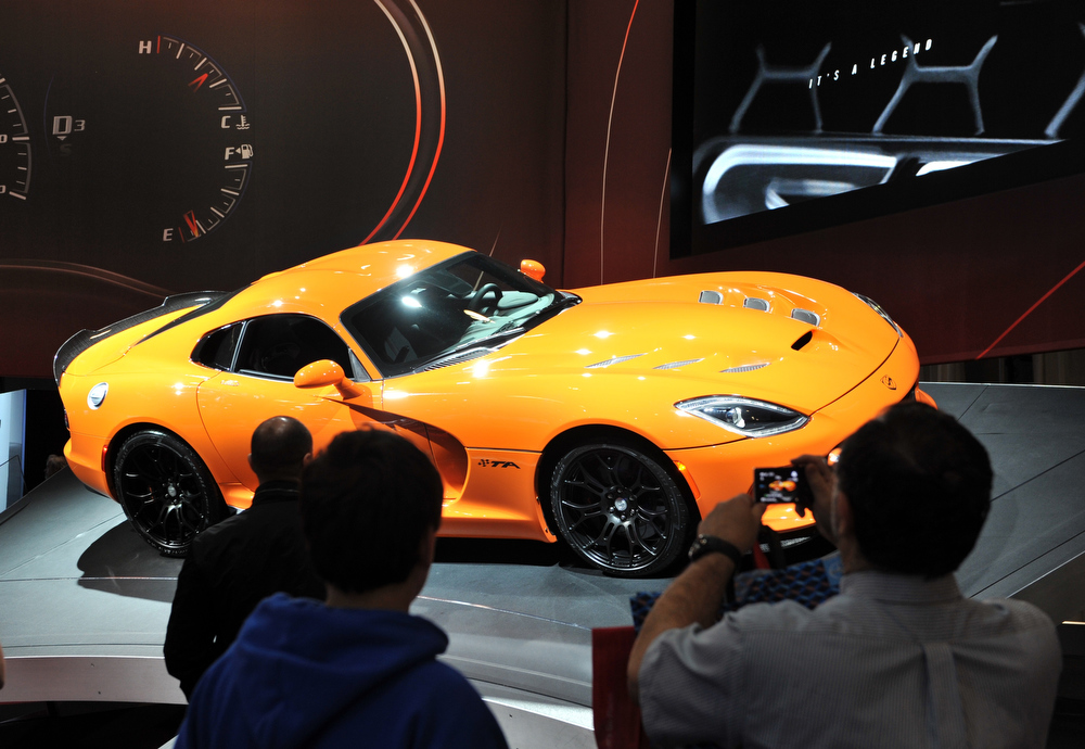 Description of . People view a 2014 SRT Viper TA at a public preview of the New York International Auto Show on March 29, 2013 in New York.  STAN HONDA/AFP/Getty Images