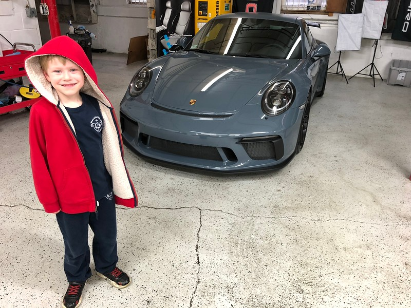 Miles poses with a 2018 GT3 with a manual.  Wow.