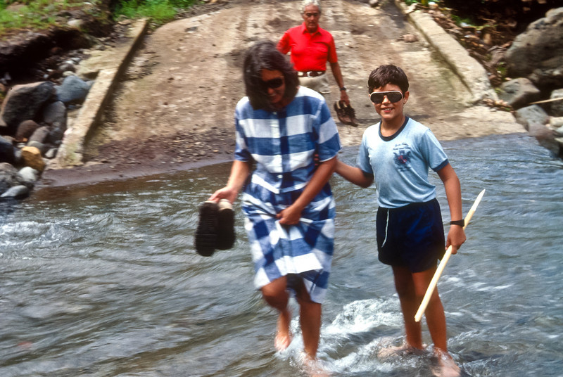 Michael and Nancy fording a washed out road.