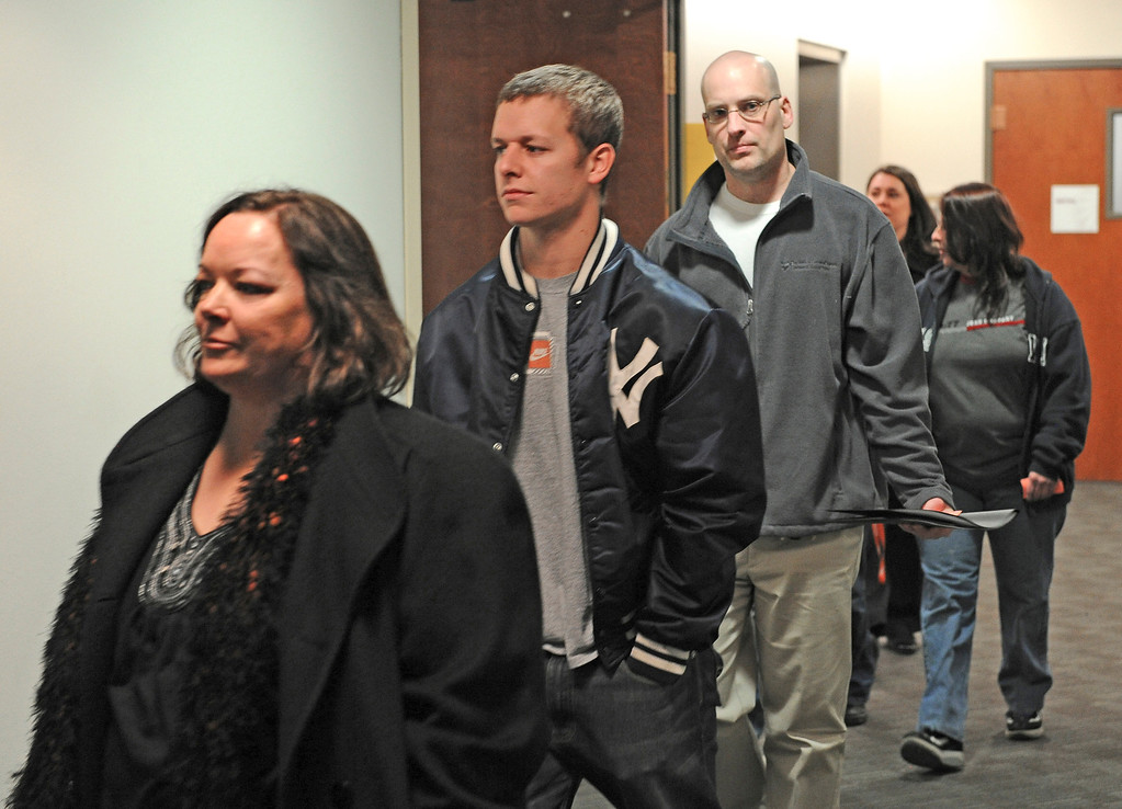 . CENTENNIAL, CO - JANUARY 11: Family members and victims enter the second floor of the Arapahoe County Courthouse, Friday, January 11, 2013 on their way to the courtroom. The  arraignment for Aurora theater shooting suspect James Holmes  was postponed until March 2013 for the July 20 shooting at the Century 16 theater that killed 12 people and injured 70 others. (Photo By Tim Rasmussen/The Denver Post)