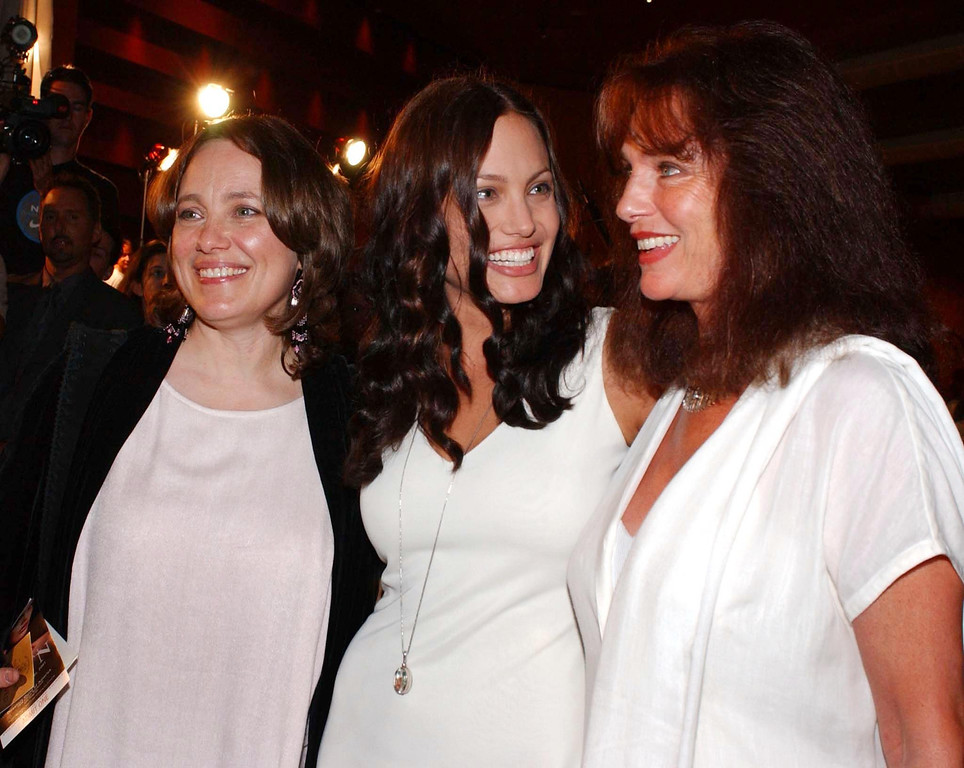 """. WEST HOLLYWOOD, UNITED STATES:  US actress Angelina Jolie (C) chats with her mother Marcheline Bertrand (L) and British actress Jacqueline Bisset (R) at the premiere of her new film \""""Original Sin\"""", in West Hollywood, CA, 31 July 2001. Jolie stars in the sexual thriller with Spanish actor Antonio Banderas.  (LUCY NICHOLSON/AFP/Getty Images)"""