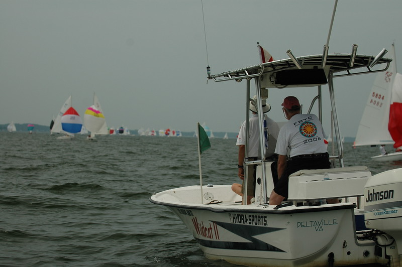 Dale and Tom Roberts on the gate boat watching the fleet come downwind.