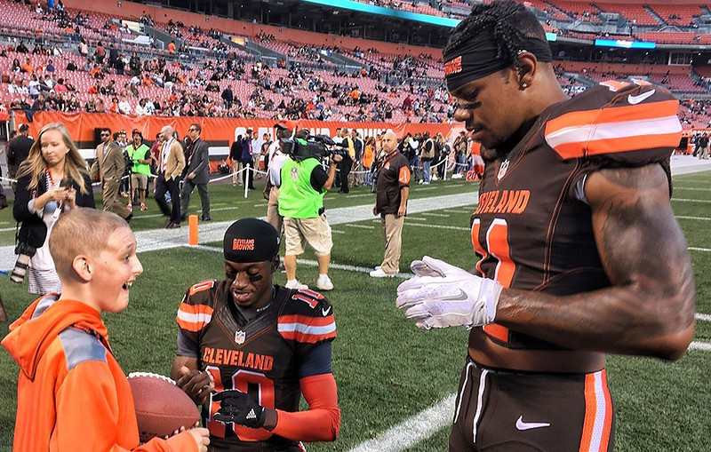 . Submitted Austin Shough of Westlake meets Browns quarterback Robert Griffin III and wide receiver Terrelle Pryor on the field at FirstEnergy stadium before the Browns\' preseason game against the Bears on Sept. 1.