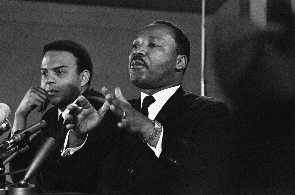 . Dr. Martin Luther King, Jr.,  Feb. 7, 1968 promised a massive demonstration this spring in Washington and hinted the crusade may be extended to the political party conventions in August. King, president of the Southern Christian Leadership Conference said the demonstration in Washington will last for weeks and maybe for months. At left is the Rev. Andrew Young, executive Vice President of the Southern Conference. (AP Photo)