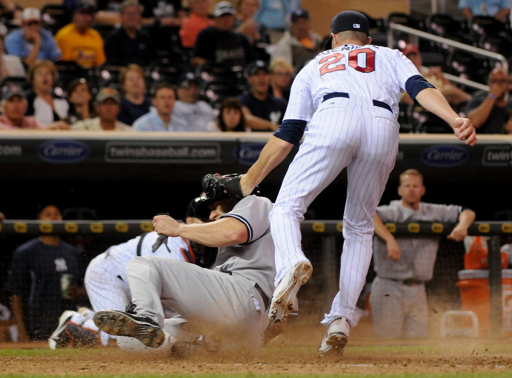 . New York designated hitter Travis Hafner scores from third on a passed ball by Minnesota relief pitcher Josh Roenicke during the eighth inning. (Pioneer Press: John Autey)