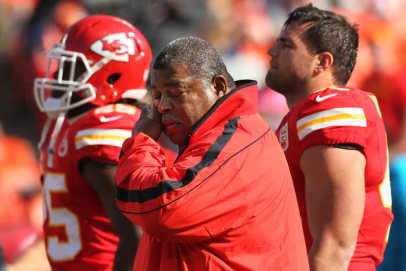 . Kansas City Chiefs coach Romeo Crennel wipes his eyes before an NFL football game against the Carolina Panthers at Arrowhead Stadium in Kansas City, Mo., Sunday, Dec. 2, 2012. (AP Photo/Colin E. Braley)