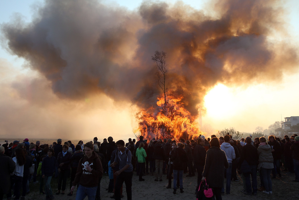 . Spectators watch a traditional Easter Fire on the eve of Easter Sunday, April 19, 2014 on the banks of the river Elbe in Hamburg\'s Blankenese district, northern Germany.    AFP PHOTO / BODO MARKS /AFP/Getty Images