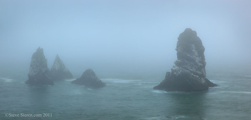 Waiting out the fog amongst sea cliffs with a view of remote sea stacks on California's Lost Coast.