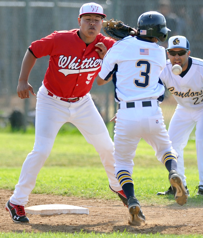 . Whittier first baseman Johnny Salgado (#5) can\'t get to the wide throw and collides with California\'s Dominick Rodriguez (#3) in their Del Rio League game at California High School in Whittier on Friday March 22, 2013. California beat Whittier 6-0. (SGVN/Staff Photo by Keith Durflinger)