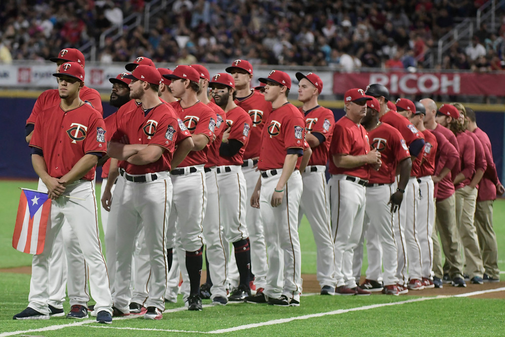 . CORRECTS RIVAL TEAM TO CLEVELAND INDIANS - Minnesota Twins players line up before game one of a two-game MLB Series against the Cleveland Indians at Hiram Bithorn Stadium in San Juan, Puerto Rico, Tuesday, April 17, 2018. (AP Photo/Carlos Giusti)