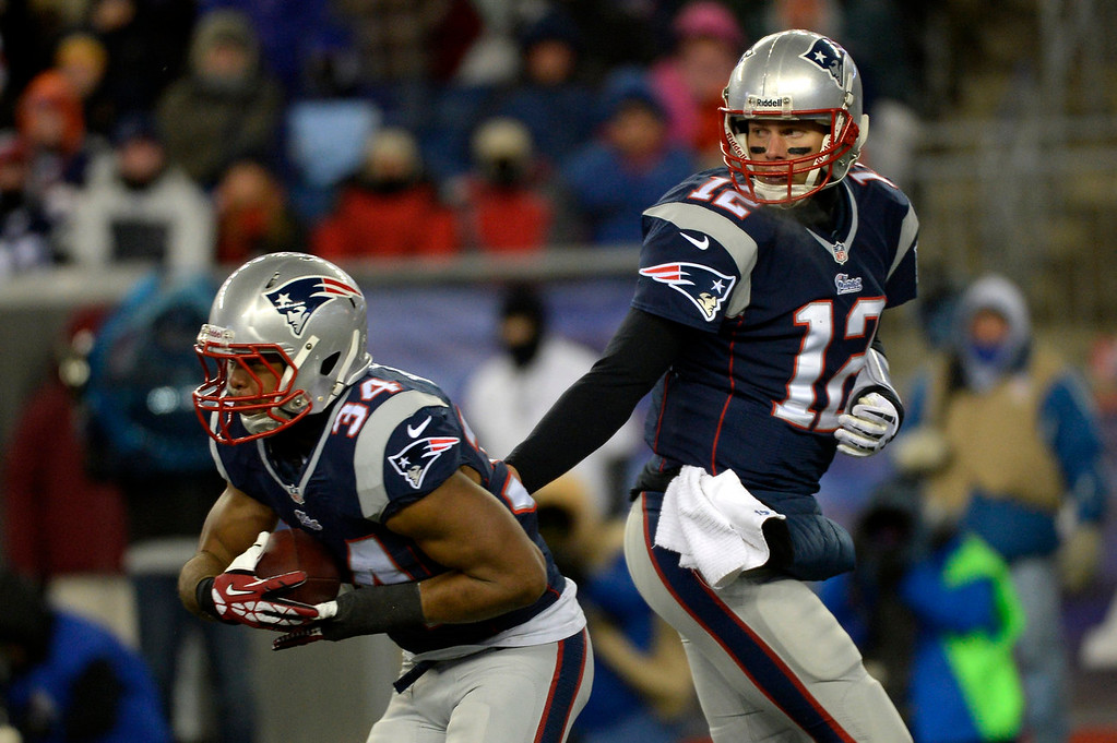 . Quarterback Tom Brady #12 of the New England Patriots hands off to running back Shane Vereen #34 at Gillette Stadium in Foxborough MA, November 24, 2013 Denver. (Photo By Joe Amon/The Denver Post)