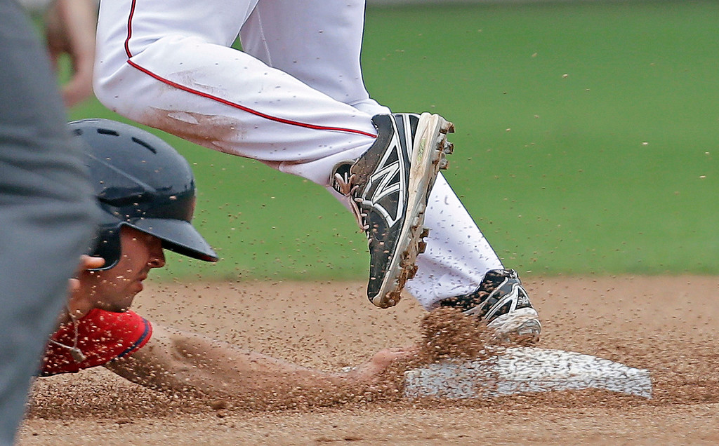 . Minnesota Twins\' Levi Michael is caught out trying to return to second base as Boston Red Sox second baseman Heiker Meneses covers on a double play off the bat of the Twins\' Josh Willingham during the sixth inning of an exhibition baseball game in Fort Myers, Fla., Saturday, March 29, 2014. (AP Photo/Gerald Herbert)