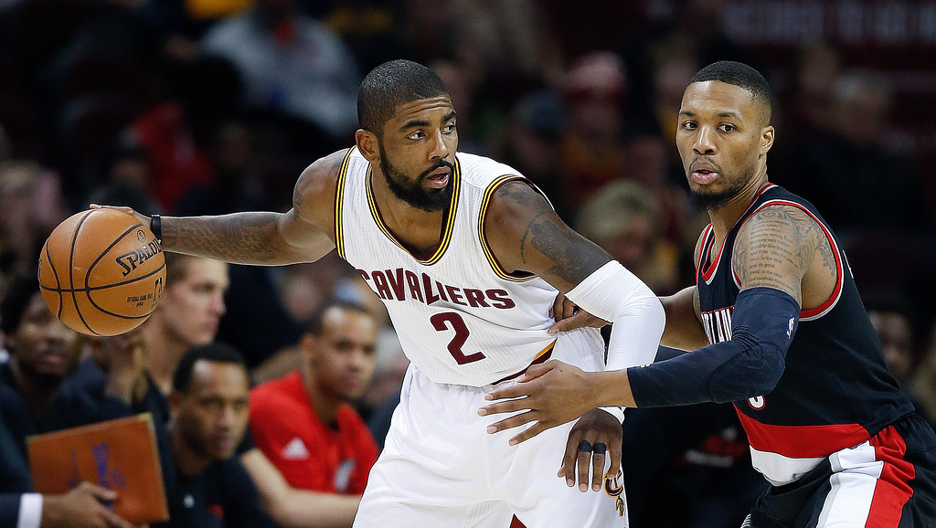 . Cleveland Cavaliers\' Kyrie Irving (2) looks to pass against Portland Trail Blazers\' Damian Lillard (0) during the second half of an NBA basketball game Wednesday, Nov. 23, 2016, in Cleveland. The Cavaliers won 137-125. (AP Photo/Ron Schwane)
