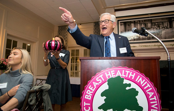 10/10/19 Wesley Bunnell | StaffrrThe CT Breast Health Initiative held their award dinner at Shuttle Meadow Country Club to honor their donors. Coleman Levy, R, helps raise money for the CTBHI by auctioning off decorated pumpkins at the end of the dinner.