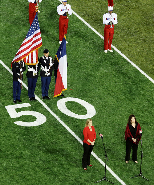 The color guard arrives.  Cynthia Clayton and Melanie Sonnenberg take their place to sing the National Anthem.