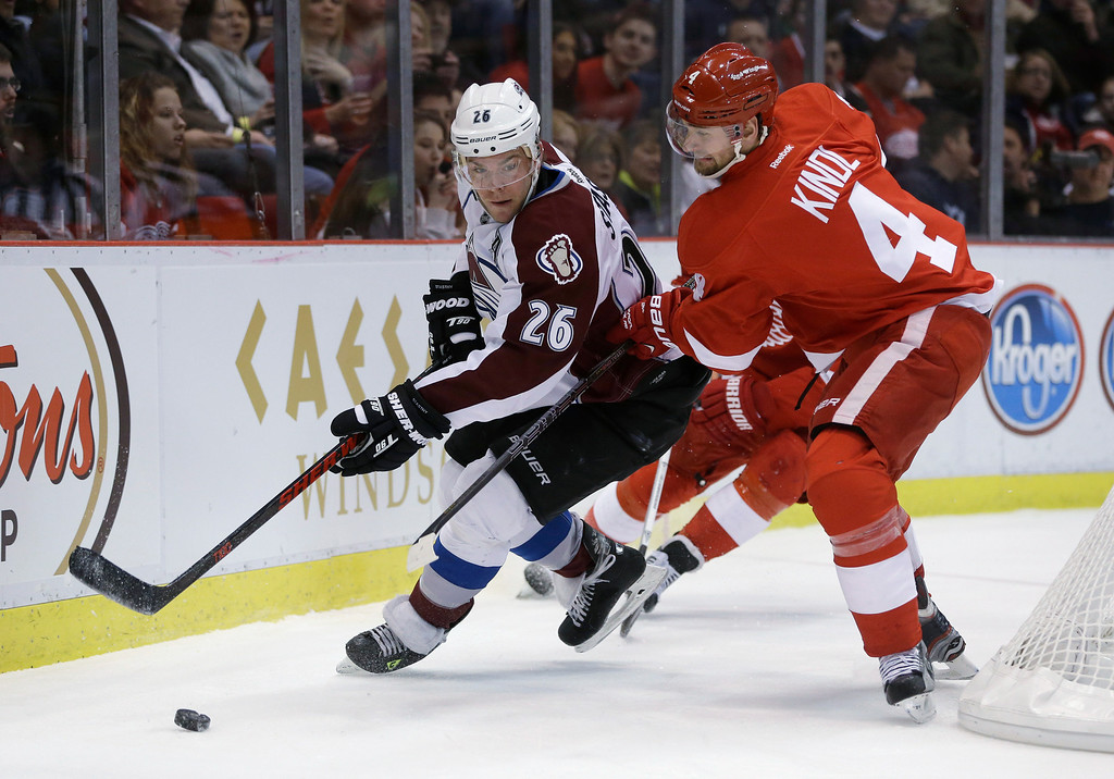 . Colorado Avalanche center Paul Stastny (26) and Detroit Red Wings defenseman Jakub Kindl (4), of the Czech Republic, vie for the puck during the first period of an NHL hockey game in Detroit, Tuesday, March 5, 2013. (AP Photo/Carlos Osorio)