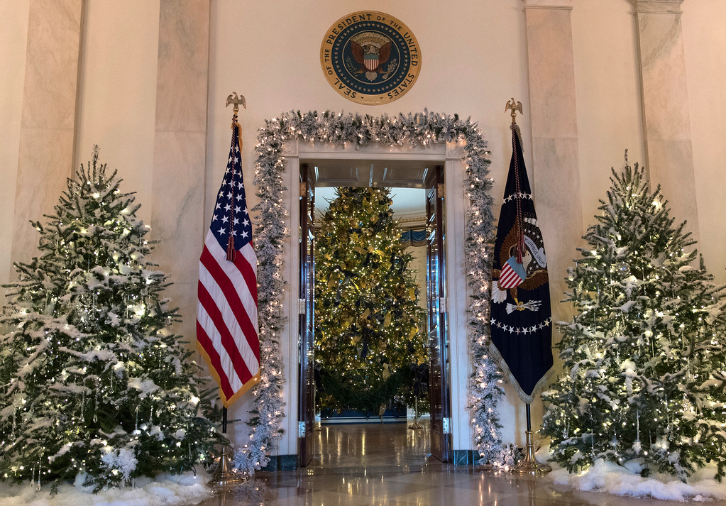 . The official White House Christmas tree, center, is seen in the Blue Room during a media preview of the 2017 holiday decorations at the White House in Washington, Monday, Nov. 27, 2017. (AP Photo/Carolyn Kaster)