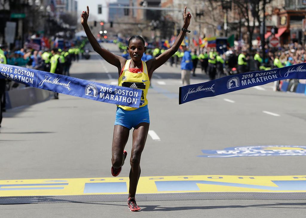 . Atsede Baysa, of Ethiopia, breaks the tape to win the women\'s division of the 120th Boston Marathon on Monday, April 18, 2016, in Boston. (AP Photo/Elise Amendola)
