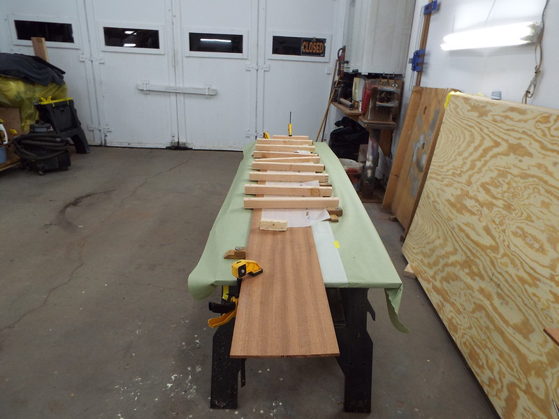 Gluing planks together to make the plank wide enough.