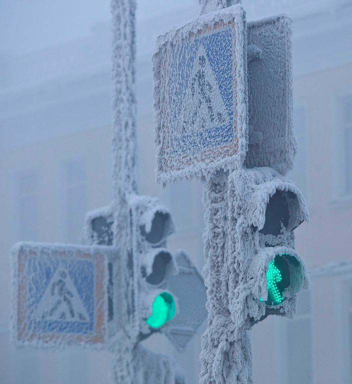 . Traffic lights are seen covered in snow in Yakutsk, in the Republic of Sakha, northeast Russia, January 17, 2013. The coldest temperatures in the northern hemisphere have been recorded in Sakha, the location of the Oymyakon valley, where according to the United Kingdom Met Office a temperature of -67.8 degrees Celsius (-90 degrees Fahrenheit) was registered in 1933 - the coldest on record in the northern hemisphere since the beginning of the 20th century. Yet despite the harsh climate, people live in the valley, and the area is equipped with schools, a post office, a bank, and even an airport runway (albeit open only in the summer). Picture taken January, 17 2013.   REUTERS/Maxim Shemetov