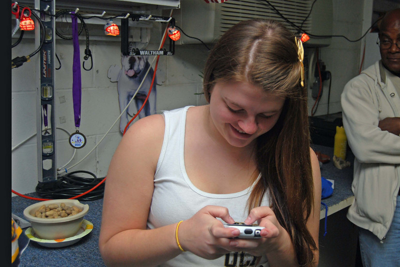 136 Allison texting at Kandi's 2010 Super Bowl Party.jpg