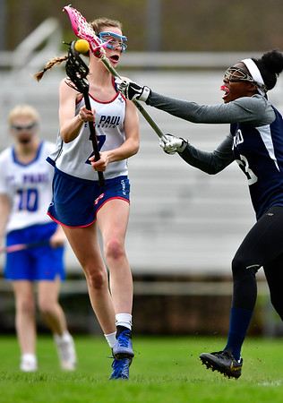 5/2/2019 Mike Orazzi | Staff St. Paul's Reagan Davis (7) during Thursday's girls lacrosse with Amistad in Bristol.