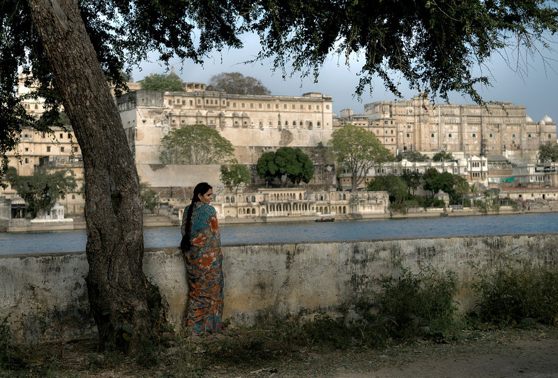 Woman looks out into Lake Pichola in Udaipur.  Rajasthan India, 2011.