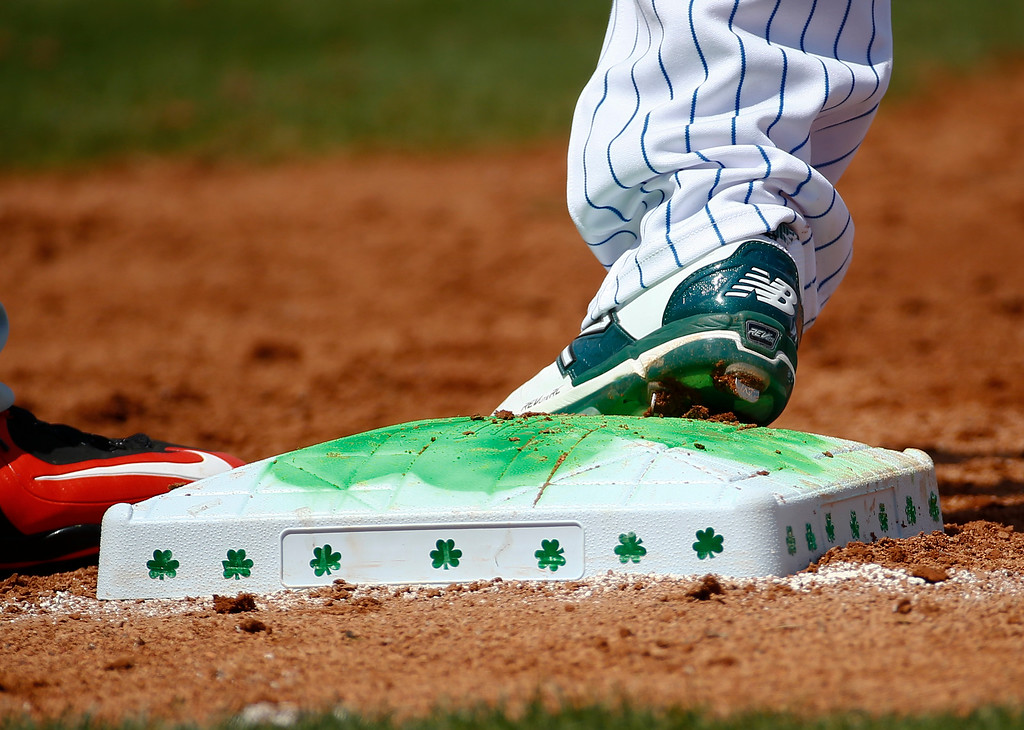 . Shamrocks adorn the bases at Traditions Field in honor of St. Patrick\'s Day during an exhibition spring training baseball game between New York Mets and Miami Marlins Tuesday, March 17, 2015, in Port St. Lucie, Fla. (AP Photo/John Bazemore)
