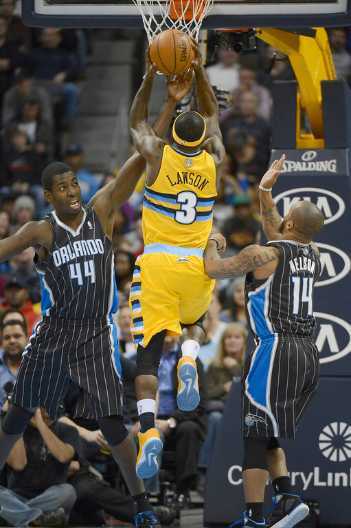 . Denver Nuggets point guard Ty Lawson (3) drives to the basket on Orlando Magic power forward Andrew Nicholson (44) during the fourth quarter Wednesday, January 9, 2013 at Pepsi Center. John Leyba, The Denver Post