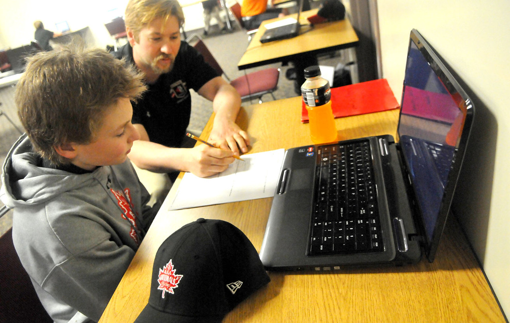 . Sixth-grader C.J. Hoyt from Apple Valley works with teacher Ben Fondrk on math problems at Northern Educate Hockey Academy.    (Pioneer Press: John Doman)