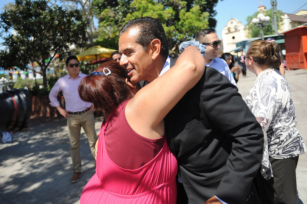 . Mayor Antonio Villaraigosa receives a hug from a passerby while visiting Olvera Street in Los Angeles, CA June 28, 2013.  Villaraigosa spent the day visiting some of his favorite loactions during his 24-hour goodbye tour.(Andy Holzman/Los Angeles Daily News)