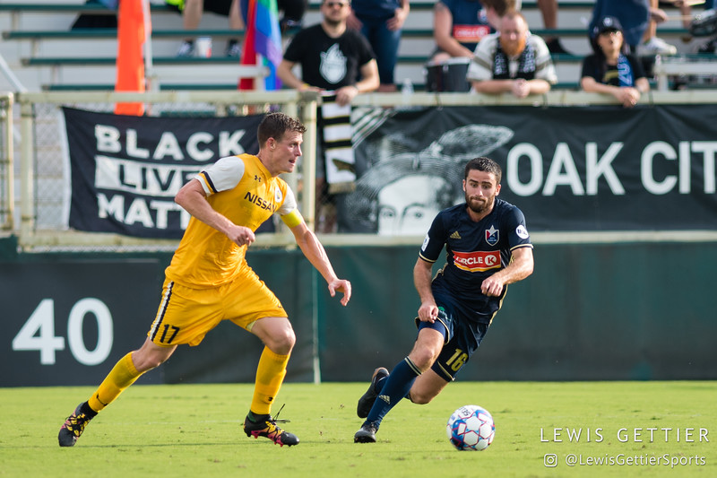 Nashville SC midfielder Michael Reed (17) and North Carolina FC midfielder Graham Smith (16)