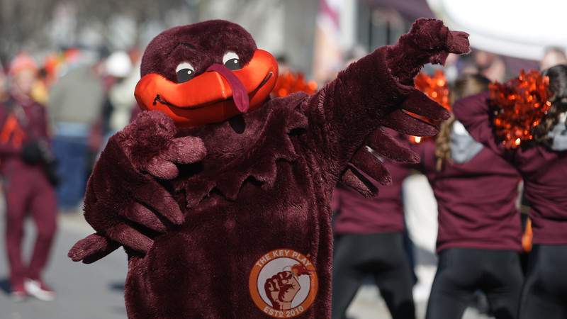The Hokiebird entertains fans gathering for the team walk from the buses to the locker rooms after arriving in Blacksburg. (Mark Umansky/TheKeyPlay.com)