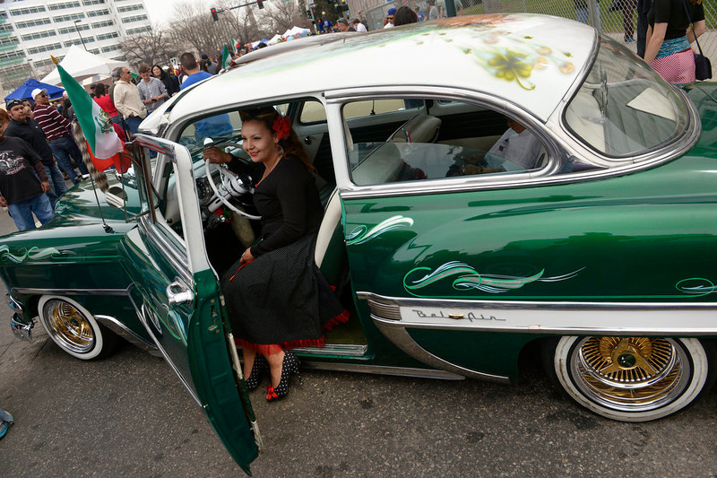 . Melissa Felan, who built this 1954 Chevy Bel Air, dressed like women did in the 1950\'s for the Low rider exhibit along Colfax Ave in downtown Denver, CO on May 5th, 2013.  The annual Cinco de Mayo celebration took place at Civic Center Park on May 5th, 2103 in Denver, CO.  Highlights this year were local traditional dancing, a taco eating contest , local bands playing traditional mexican music and Chihuahua dog racing where 132 dogs raced for the top prize of $500.(Photo by Helen H. Richardson/The Denver Post)