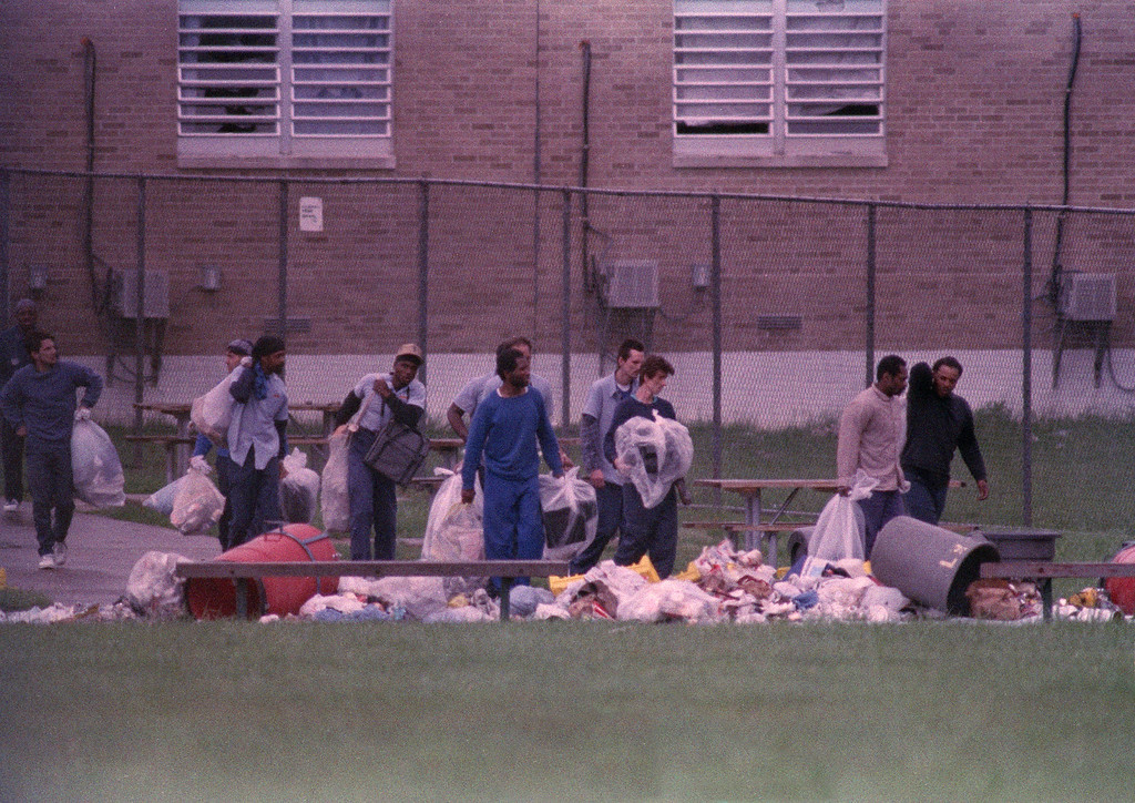 . Inmates carry their belongings from the Southern Ohio Correctional Facility in Lucasville, where they have occupied a cell block for 10 days, April 21, 1993. One guard and seven prisoners died in the siege that began on April 11, Easter Sunday. (AP Photo/Lennox McLendon/Pool)