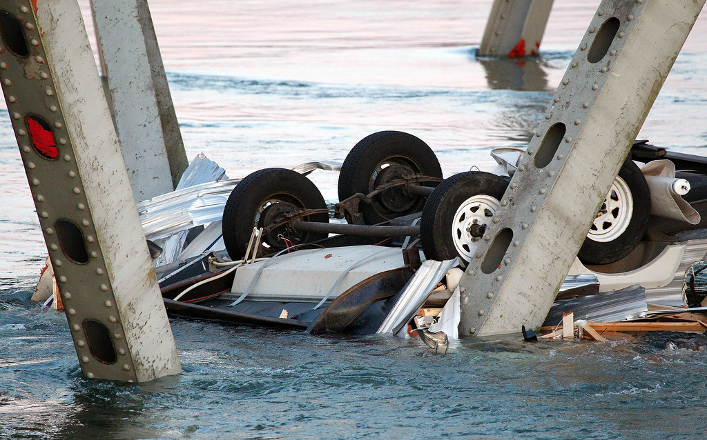 . An upside down vehicle rests in the water after a portion of the Interstate 5 bridge collapsed into the Skagit River in Mount Vernon, Wash., Thursday, May 23, 2013. (AP Photo/Everett Daily Herald, Jennifer Buchanan)
