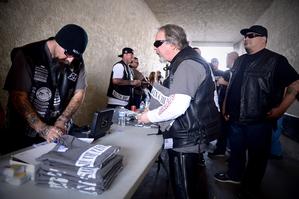 """. \""""Save the Patch\"""" t-shirts are sold as motorcycle club members rally Saturday, March 29, 2013 at The House Lounge in Maywood in support of the Mongols who are facing a federal trial seeking to take away their trademark patch. (Photo by Sarah Reingewirtz/Pasadena Star-News)"""