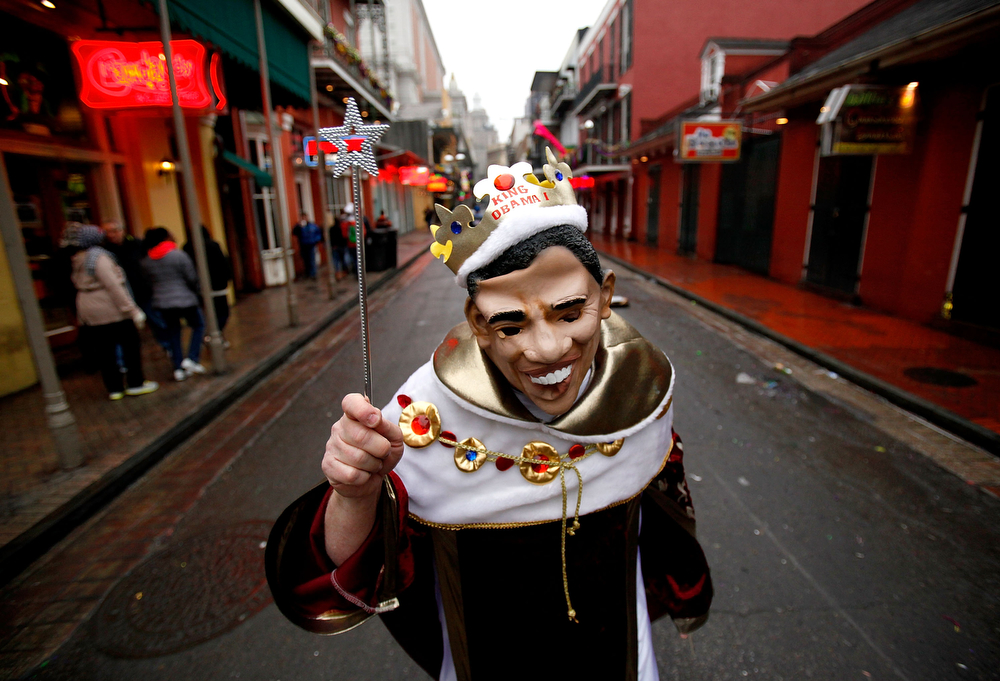 Description of . A reveler walks through the French Quarter as New Orleans Holds Citywide Mardi Gras Celebration on March 4, 2014 in New Orleans, Louisiana.  Fat Tuesday, the traditional celebration on the day before Ash Wednesday and the beginning of Lent, is marked in New Orleans with parades and marches through many neighborhoods in the city.(Photo by Sean Gardner/Getty Images)