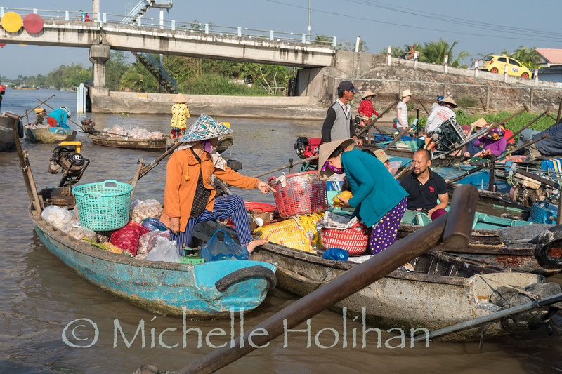 CAN THO, VIETNAM - FEBRUARY 22, 2019: Undentified people sell produce and hot food from their boats at the Cai Rang Floating Market.