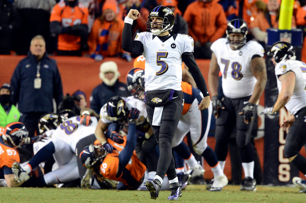 Description of . Baltimore Ravens quarterback Joe Flacco (5) celebrates the 28 to 28 touchdown during the second half.  The Denver Broncos vs Baltimore Ravens AFC Divisional playoff game at Sports Authority Field Saturday January 12, 2013. (Photo by Hyoung Chang,/The Denver Post)
